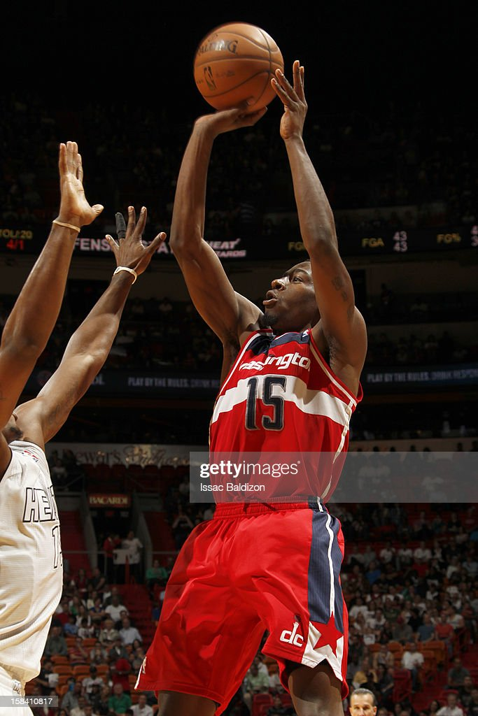 Jordan Crawford #15 of the Washington Wizards goes to the basket during a game between the Washington Wizards and the Miami Heat on December 15, 2012 at American Airlines Arena in Miami, Florida.