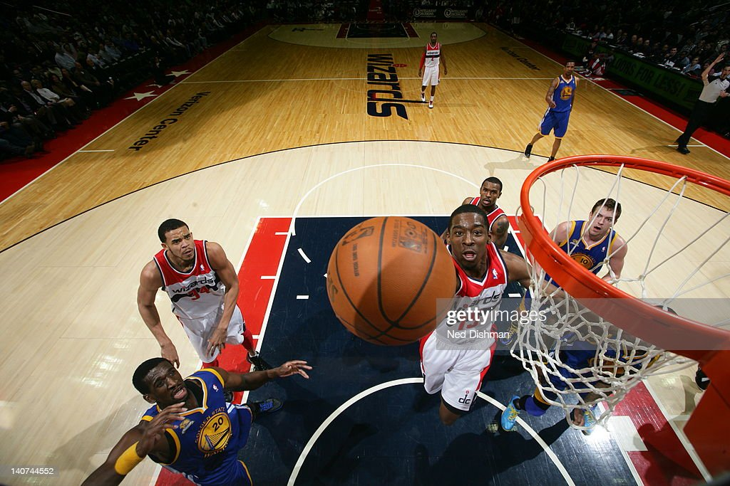 <a gi-track='captionPersonalityLinkClicked' href=/galleries/search?phrase=Jordan+Crawford&family=editorial&specificpeople=4779380 ng-click='$event.stopPropagation()'>Jordan Crawford</a> #15 of the Washington Wizards goes to the basket during the game between the Washington Wizards and the Golden State Warriors at the Verizon Center on March 5, 2012 in Washington, DC.