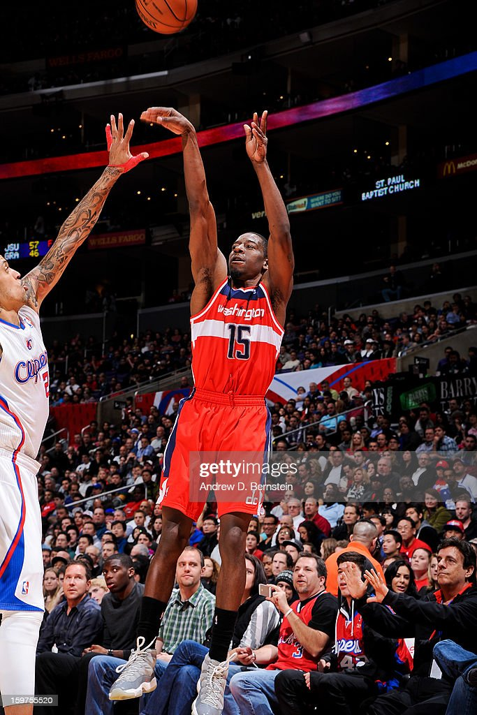 Jordan Crawford #15 of the Washington Wizards shoots a three-pointer against Matt Barnes #22 of the Los Angeles Clippers at Staples Center on January 19, 2013 in Los Angeles, California.