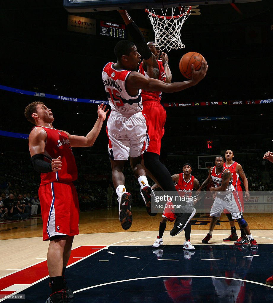 <a gi-track='captionPersonalityLinkClicked' href=/galleries/search?phrase=Jordan+Crawford&family=editorial&specificpeople=4779380 ng-click='$event.stopPropagation()'>Jordan Crawford</a> #15 of the Washington Wizards shoots against <a gi-track='captionPersonalityLinkClicked' href=/galleries/search?phrase=Blake+Griffin+-+Basketball+Player&family=editorial&specificpeople=4216010 ng-click='$event.stopPropagation()'>Blake Griffin</a> #32 of the Los Angeles Clippers during the game at the Verizon Center on February 4, 2012 in Washington, DC.