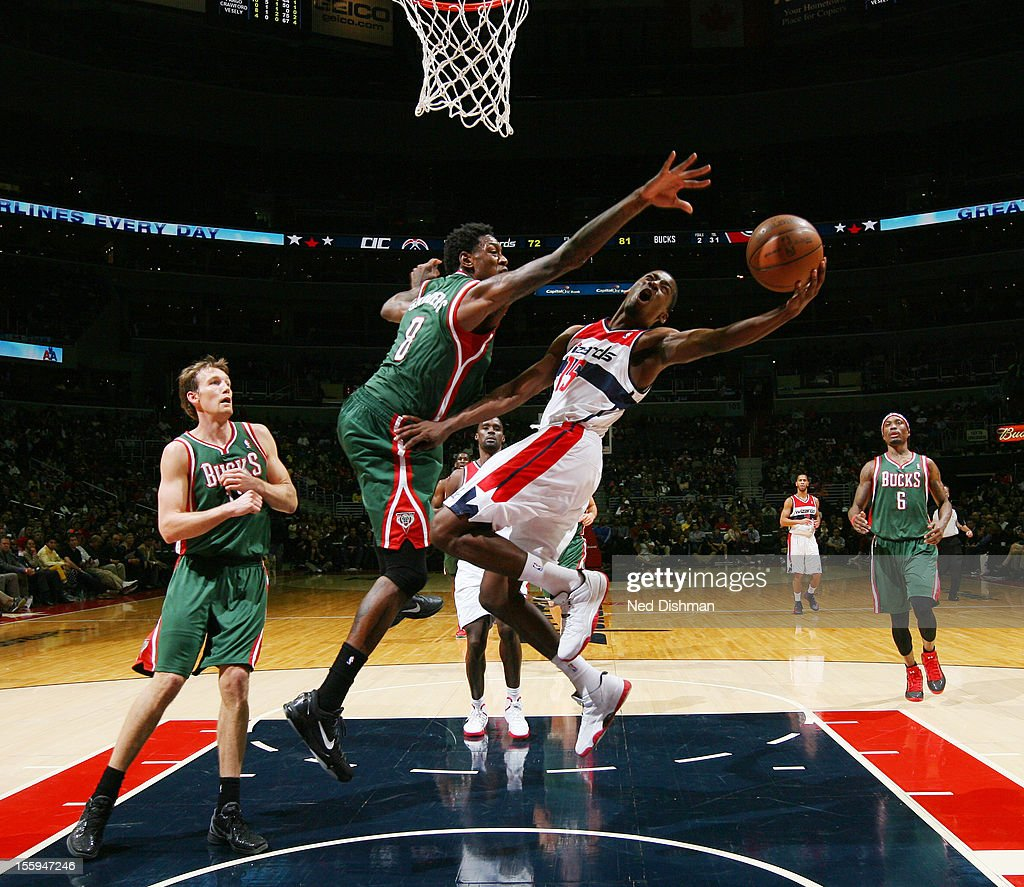 <a gi-track='captionPersonalityLinkClicked' href=/galleries/search?phrase=Jordan+Crawford&family=editorial&specificpeople=4779380 ng-click='$event.stopPropagation()'>Jordan Crawford</a> #15 of the Washington Wizards shoots against Larry Sanders #8 of the Milwaukee Bucks during the game at the Verizon Center on November 9, 2012 in Washington, DC.