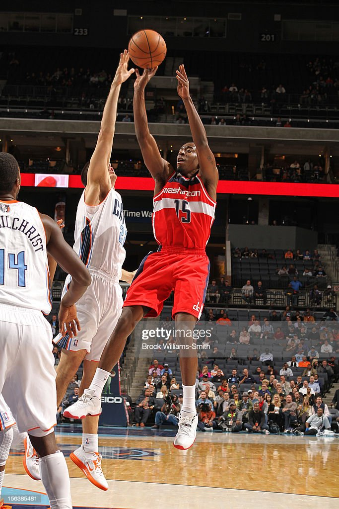 <a gi-track='captionPersonalityLinkClicked' href=/galleries/search?phrase=Jordan+Crawford&family=editorial&specificpeople=4779380 ng-click='$event.stopPropagation()'>Jordan Crawford</a> #15 Washington Wizards attempts a shot over Byron Mullens #22 of the Charlotte Bobcats at the Time Warner Cable Arena on November 13, 2012 in Charlotte, North Carolina.