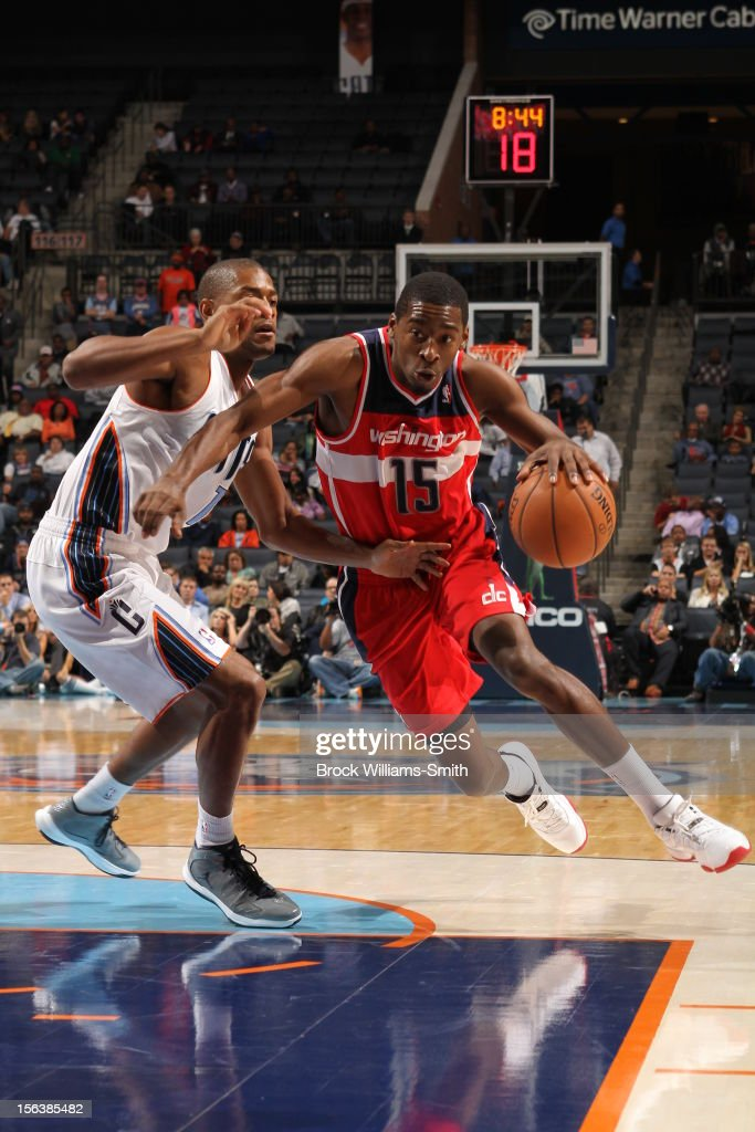 <a gi-track='captionPersonalityLinkClicked' href=/galleries/search?phrase=Jordan+Crawford&family=editorial&specificpeople=4779380 ng-click='$event.stopPropagation()'>Jordan Crawford</a> #15 Washington Wizards drives to the basket against <a gi-track='captionPersonalityLinkClicked' href=/galleries/search?phrase=Ramon+Sessions&family=editorial&specificpeople=805440 ng-click='$event.stopPropagation()'>Ramon Sessions</a> #7 of the Charlotte Bobcats at the Time Warner Cable Arena on November 13, 2012 in Charlotte, North Carolina.