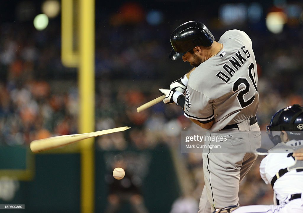 Jordan Danks #20 of the Chicago White Sox breaks his baseball bat while he bats during the game against the Detroit Tigers at Comerica Park on September 20, 2013 in Detroit, Michigan. The Tigers defeated the White Sox 12-5.