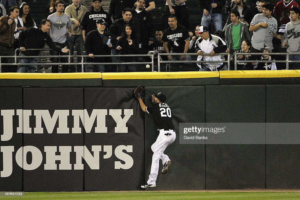 Jordan Danks #20 of the Chicago White Sox can't make a catch on a double by Jose Molina #28 of the Tampa Bay Rays during the ninth inning on April 26, 2013 at U.S. Cellular Field in Chicago, Illinois. The Chicago White Sox defeated the Tampa Bay Rays 5-4.