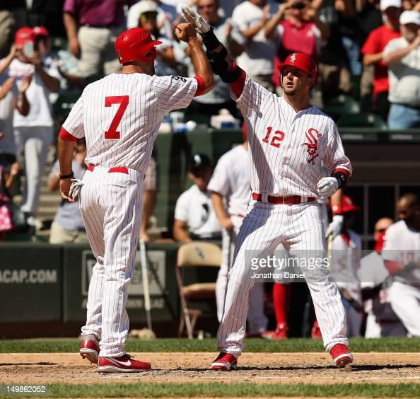 Jordan Danks of the Chicago White Sox congratulates AJ Pierzynski after Pierzynski's tworun pinchhit home run against the Los Angeles Angels of...