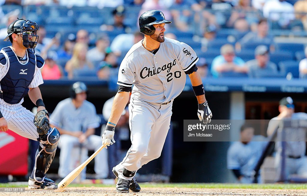 <a gi-track='captionPersonalityLinkClicked' href=/galleries/search?phrase=Jordan+Danks&family=editorial&specificpeople=2364706 ng-click='$event.stopPropagation()'>Jordan Danks</a> #20 of the Chicago White Sox follows through on a tenth inning base hit against the New York Yankees at Yankee Stadium on August 24, 2014 in the Bronx borough of New York City. The Yankees defeated the White Sox 7-4 in ten innings.