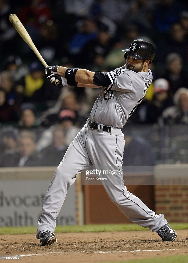 <a gi-track='captionPersonalityLinkClicked' href=/galleries/search?phrase=Jordan+Danks&family=editorial&specificpeople=2364706 ng-click='$event.stopPropagation()'>Jordan Danks</a> #20 of the Chicago White Sox follows through on an RBI double scoring Moises Sierra #25 and Tyler Flowers #21 during the ninth inning at Wrigley Field on May 6, 2014 in Chicago, Illinois.