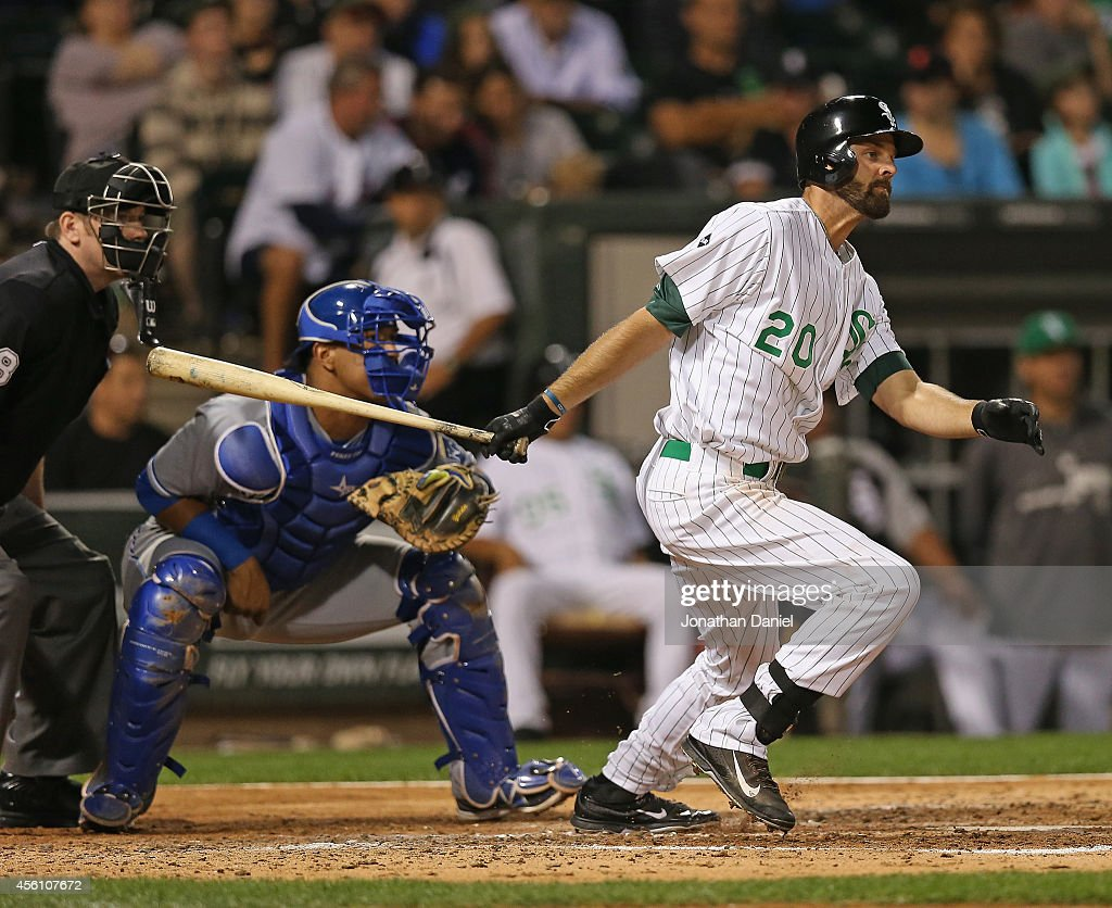 <a gi-track='captionPersonalityLinkClicked' href=/galleries/search?phrase=Jordan+Danks&family=editorial&specificpeople=2364706 ng-click='$event.stopPropagation()'>Jordan Danks</a> #20 of the Chicago White Sox hits a run-scoring signle in the 4th inning against the Kansas City Royals at U.S. Cellular Field on September 25, 2014 in Chicago, Illinois.