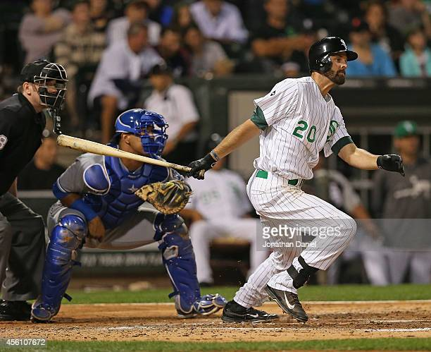 Jordan Danks of the Chicago White Sox hits a runscoring signle in the 4th inning against the Kansas City Royals at US Cellular Field on September 25...