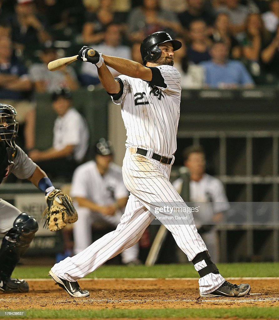 <a gi-track='captionPersonalityLinkClicked' href=/galleries/search?phrase=Jordan+Danks&family=editorial&specificpeople=2364706 ng-click='$event.stopPropagation()'>Jordan Danks</a> #20 of the Chicago White Sox hits a single in the 8th inning against the Detroit Tigers at U.S. Cellular Field on August 12, 2013 in Chicago, Illinois. The White Sox defeated the Tigers 6-2.