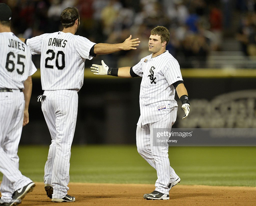 <a gi-track='captionPersonalityLinkClicked' href=/galleries/search?phrase=Jordan+Danks&family=editorial&specificpeople=2364706 ng-click='$event.stopPropagation()'>Jordan Danks</a> #20 of the Chicago White Sox hugs teammate Josh Phegley #36 after Phegley hit a game-winning, RBI single during the ninth inning of the 2013 Civil Rights Game against the Texas Rangers at U.S. Cellular Field on August 24, 2013 in Chicago, Illinois. The White Sox won 3-2.