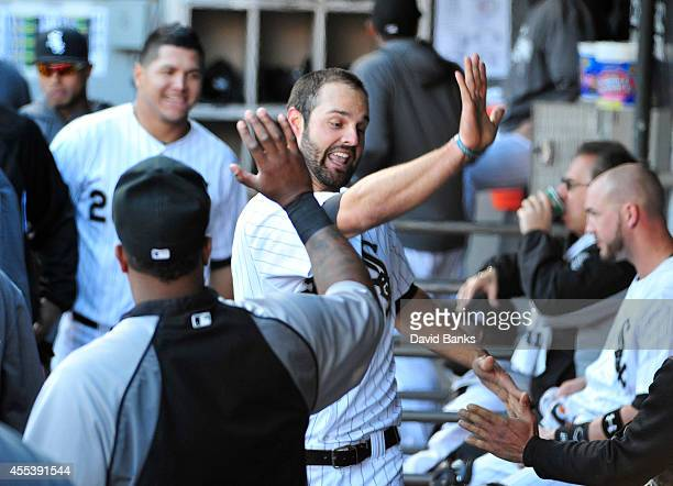 Jordan Danks of the Chicago White Sox is greeted after scoring against the Minnesota Twins during the seventh inningin game one of a doubleheader on...