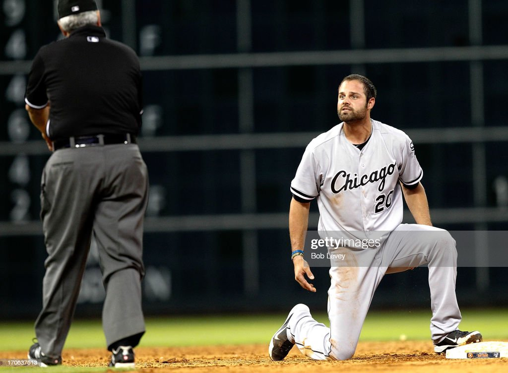 <a gi-track='captionPersonalityLinkClicked' href=/galleries/search?phrase=Jordan+Danks&family=editorial&specificpeople=2364706 ng-click='$event.stopPropagation()'>Jordan Danks</a> #20 of the Chicago White Sox looks at second base umpire Dana DeMuth after he was picked off to end the game against the Houston Astros at Minute Maid Park on June 15, 2013 in Houston, Texas.