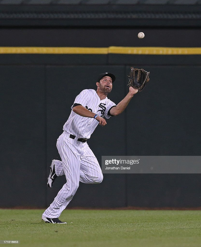 <a gi-track='captionPersonalityLinkClicked' href=/galleries/search?phrase=Jordan+Danks&family=editorial&specificpeople=2364706 ng-click='$event.stopPropagation()'>Jordan Danks</a> #20 of the Chicago White Sox makes a catch in the 9th inning against the New York Mets at U.S. Cellular Field on June 25, 2013 in Chicago, Illinois. The White Sox defeated the Mets 5-4.