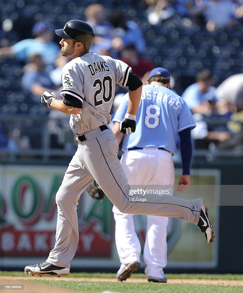 Jordan Danks #20 of the Chicago White Sox passes <a gi-track='captionPersonalityLinkClicked' href=/galleries/search?phrase=Mike+Moustakas&family=editorial&specificpeople=6780077 ng-click='$event.stopPropagation()'>Mike Moustakas</a> #8 of the Kansas City Royals as he runs the bases after hitting a home run in the 11th inning at Kauffman Stadium on May 6, 2013 in Kansas City, Missouri. The White Sox won 2-1 in 11 innings.