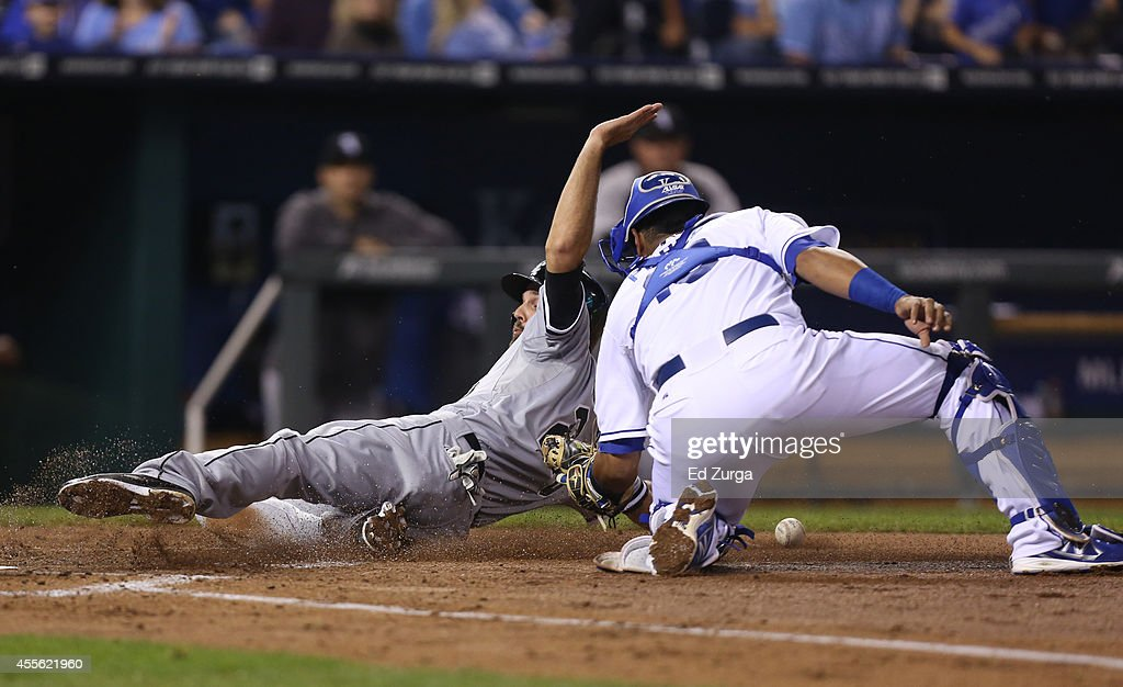 <a gi-track='captionPersonalityLinkClicked' href=/galleries/search?phrase=Jordan+Danks&family=editorial&specificpeople=2364706 ng-click='$event.stopPropagation()'>Jordan Danks</a> #20 of the Chicago White Sox slides safely across home past Salvador Perez #13 of the Kansas City Royals as he scores on an Adam Eaton sacrifice fly in the third inning at Kauffman Stadium on September 17, 2012 in Kansas City, Missouri.