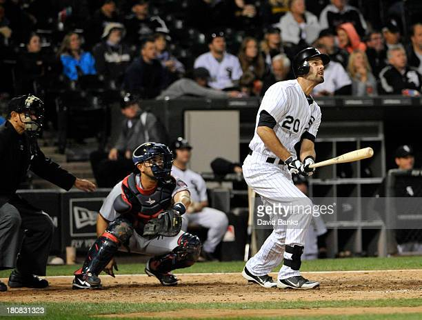 Jordan Danks of the Chicago White Sox watches his tworun homer against the Minnesota Twins during the sixth inning on September 16 2013 at US...