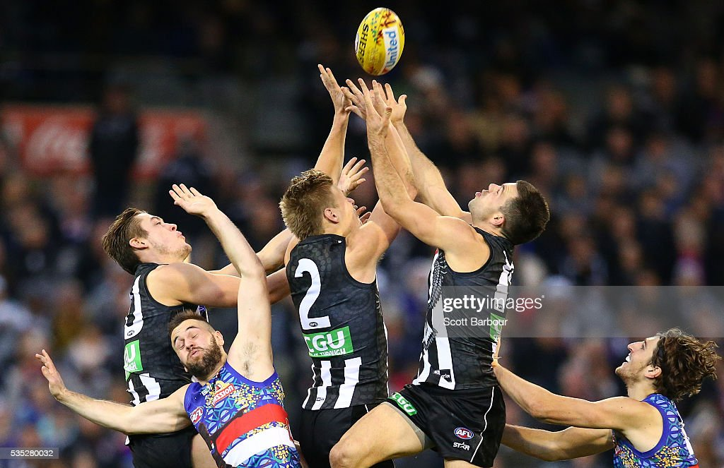 Jordan De Goey of the Magpies, Darcy Moore of the Magpies and Levi Greenwood of the Magpies compete for the ball during the round 10 AFL match between the Collingwood Magpies and the Western Bulldogs at Melbourne Cricket Ground on May 29, 2016 in Melbourne, Australia.