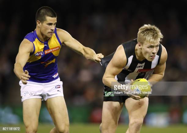 Jordan De Goey of the Magpies is tackled by Liam Duggan of the Eagles during the 2017 AFL round 18 match between the Collingwood Magpies and the West...