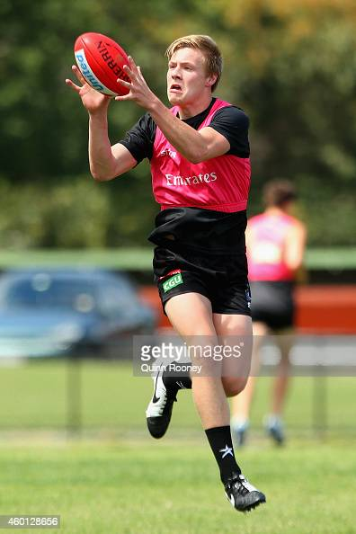 Jordan De Goey of the Magpies marks during a Collingwood AFL preseason training session at Westpac Centre on December 8 2014 in Melbourne Australia