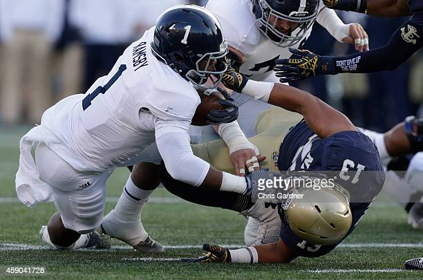 Jordan Drake of the Navy Midshipmen drags down LA Ramsby of the Georgia Southern Eagles during the first half at the NavyMarines Memorial Stadium on...