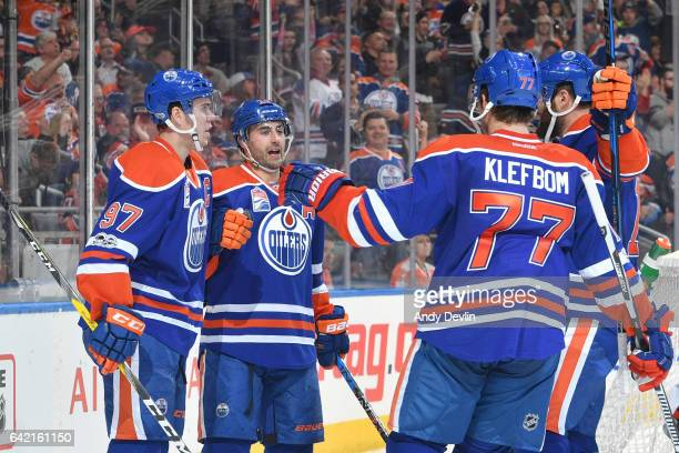Jordan Eberle Connor McDavid and Oscar Klefbom of the Edmonton Oilers celebrate after a goal during the game against the Philadelphia Flyers on...