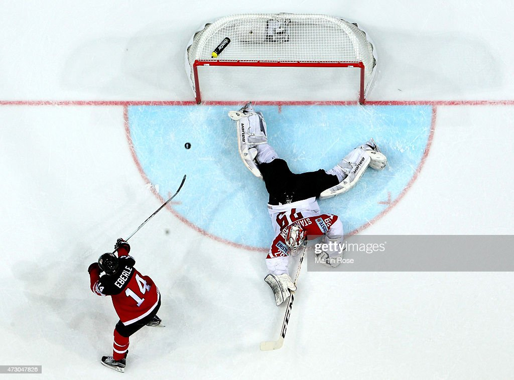 Jordan Eberle (L) of Canada scores his team's opening goal over Bernhard Starkbaum (R), goaltender of Austria during the IIHF World Championship group A match between Canada and Austria at o2 Arena on May 12, 2015 in Prague, Czech Republic.