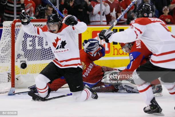 Jordan Eberle of Team Canada reacts after having scored the tying goal on Vadim Zhelobnyuk of Team Russia forcing overtime during the semifinals at...
