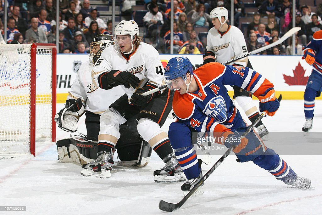 <a gi-track='captionPersonalityLinkClicked' href=/galleries/search?phrase=Jordan+Eberle&family=editorial&specificpeople=4898161 ng-click='$event.stopPropagation()'>Jordan Eberle</a> #14 of the Edmonton Oilers battles for position in front of the net against Sami Vatanen #45 of the Anaheim Ducks on April 21, 2013 at Rexall Place in Edmonton, Alberta, Canada.
