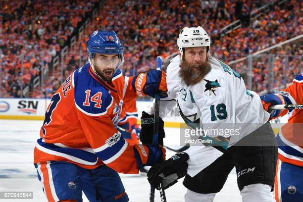 Jordan Eberle of the Edmonton Oilers battles for the puck against Joe Thornton of the San Jose Sharks in Game Five of the Western Conference First...