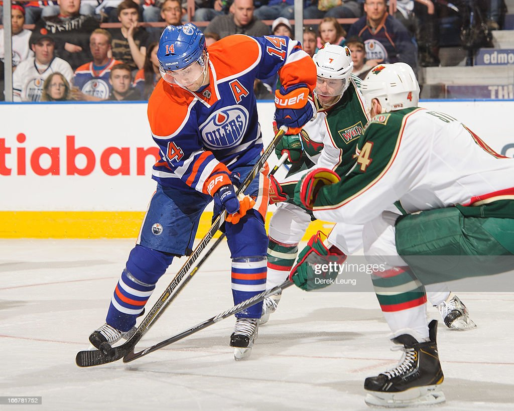 <a gi-track='captionPersonalityLinkClicked' href=/galleries/search?phrase=Jordan+Eberle&family=editorial&specificpeople=4898161 ng-click='$event.stopPropagation()'>Jordan Eberle</a> #14 of the Edmonton Oilers battles for the puck against <a gi-track='captionPersonalityLinkClicked' href=/galleries/search?phrase=Clayton+Stoner&family=editorial&specificpeople=2222214 ng-click='$event.stopPropagation()'>Clayton Stoner</a> #4 and <a gi-track='captionPersonalityLinkClicked' href=/galleries/search?phrase=Matt+Cullen&family=editorial&specificpeople=536122 ng-click='$event.stopPropagation()'>Matt Cullen</a> #7 of the Minnesota Wild during an NHL game at Rexall Place on April 16, 2013 in Edmonton, Alberta, Canada.