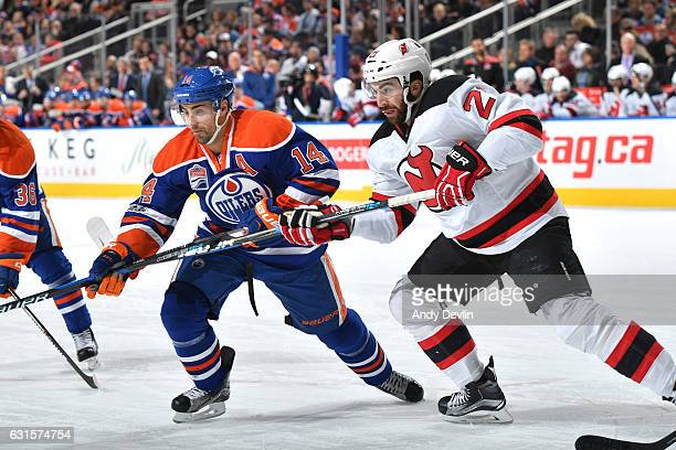 Jordan Eberle of the Edmonton Oilers battles for the puck against Kyle Palmieri of the New Jersey Devils on January 12 2017 at Rogers Place in...