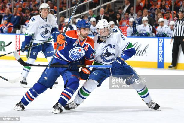 Jordan Eberle of the Edmonton Oilers battles for the puck against Troy Stecher of the Vancouver Canucks on April 9 2017 at Rogers Place in Edmonton...