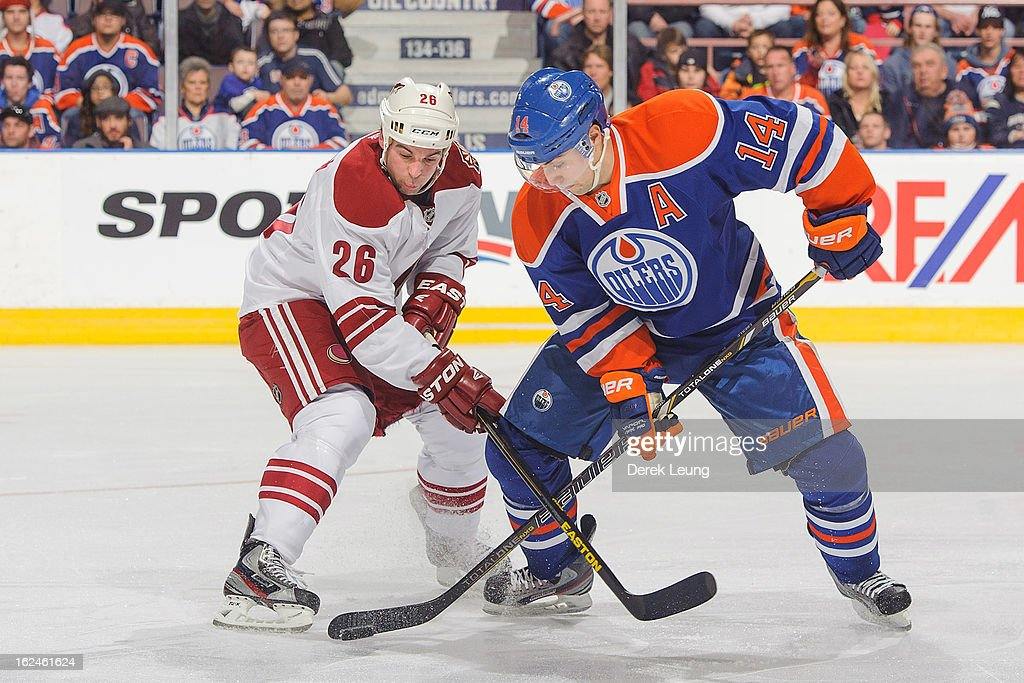<a gi-track='captionPersonalityLinkClicked' href=/galleries/search?phrase=Jordan+Eberle&family=editorial&specificpeople=4898161 ng-click='$event.stopPropagation()'>Jordan Eberle</a> #14 of the Edmonton Oilers battles for the puck with <a gi-track='captionPersonalityLinkClicked' href=/galleries/search?phrase=Steve+Sullivan&family=editorial&specificpeople=201723 ng-click='$event.stopPropagation()'>Steve Sullivan</a> #26 of the Minnesota Wild during an NHL game at Rexall Place on February 23, 2013 in Edmonton, Alberta, Canada.