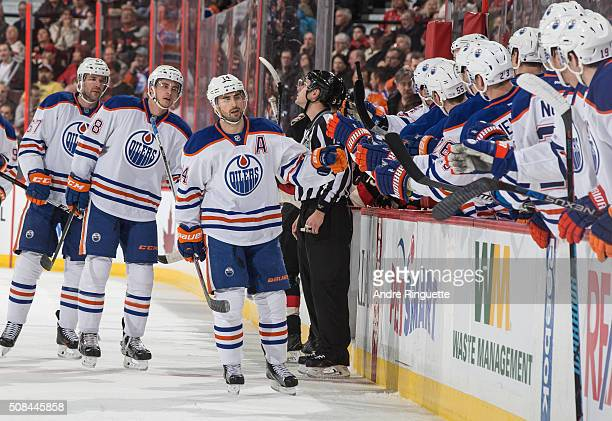 Jordan Eberle of the Edmonton Oilers celebrates his first of two 1st period goals against the Ottawa Senators with teammates at the players bench at...