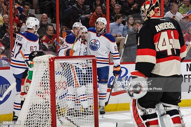 Jordan Eberle of the Edmonton Oilers celebrates his firstperiod goal against the Ottawa Senators with team mates Benoit Pouliot Connor McDavid and...