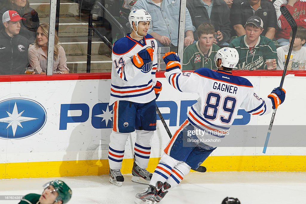 <a gi-track='captionPersonalityLinkClicked' href=/galleries/search?phrase=Jordan+Eberle&family=editorial&specificpeople=4898161 ng-click='$event.stopPropagation()'>Jordan Eberle</a> #14 of the Edmonton Oilers celebrates with teammate <a gi-track='captionPersonalityLinkClicked' href=/galleries/search?phrase=Sam+Gagner&family=editorial&specificpeople=4042961 ng-click='$event.stopPropagation()'>Sam Gagner</a> #89 after scoring a goal against the Minnesota Wild during the game on April 26, 2013 at the Xcel Energy Center in St. Paul, Minnesota.