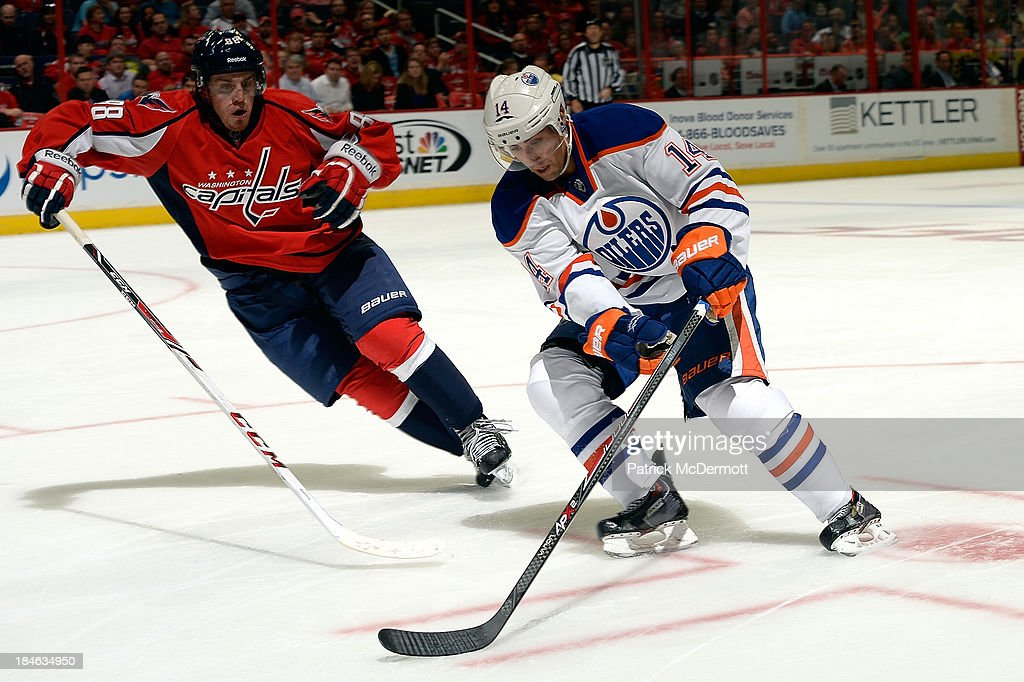 <a gi-track='captionPersonalityLinkClicked' href=/galleries/search?phrase=Jordan+Eberle&family=editorial&specificpeople=4898161 ng-click='$event.stopPropagation()'>Jordan Eberle</a> #14 of the Edmonton Oilers controls the puck against Nate Schmidt #88 of the Washington Capitals in the third period during an NHL game at Verizon Center on October 14, 2013 in Washington, DC.