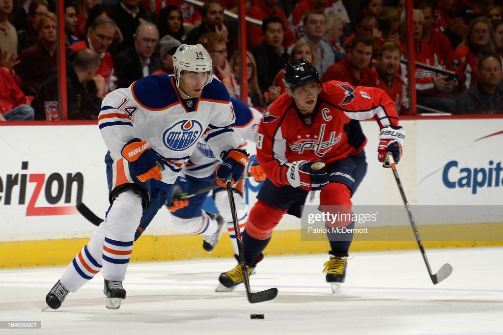 <a gi-track='captionPersonalityLinkClicked' href=/galleries/search?phrase=Jordan+Eberle&family=editorial&specificpeople=4898161 ng-click='$event.stopPropagation()'>Jordan Eberle</a> #14 of the Edmonton Oilers controls the puck as he is pursued by Alex Ovechkin #8 of the Washington Capitals in the third period during an NHL game at Verizon Center on October 14, 2013 in Washington, DC.