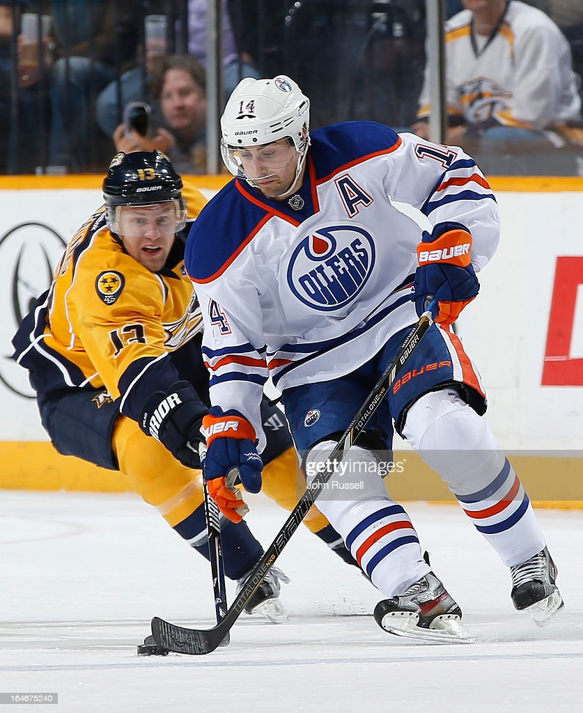 <a gi-track='captionPersonalityLinkClicked' href=/galleries/search?phrase=Jordan+Eberle&family=editorial&specificpeople=4898161 ng-click='$event.stopPropagation()'>Jordan Eberle</a> #14 of the Edmonton Oilers gets pressure from <a gi-track='captionPersonalityLinkClicked' href=/galleries/search?phrase=Nick+Spaling&family=editorial&specificpeople=4112920 ng-click='$event.stopPropagation()'>Nick Spaling</a> #13 of the Nashville Predators during an NHL game at the Bridgestone Arena on March 25, 2013 in Nashville, Tennessee.