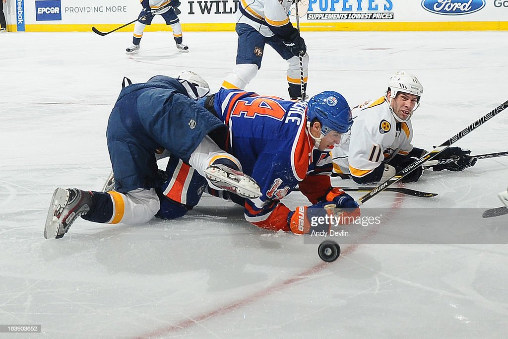 <a gi-track='captionPersonalityLinkClicked' href=/galleries/search?phrase=Jordan+Eberle&family=editorial&specificpeople=4898161 ng-click='$event.stopPropagation()'>Jordan Eberle</a> #14 of the Edmonton Oilers gets tangled up with a player of the Nashville Predators on March 17, 2013 at Rexall Place in Edmonton, Alberta, Canada.