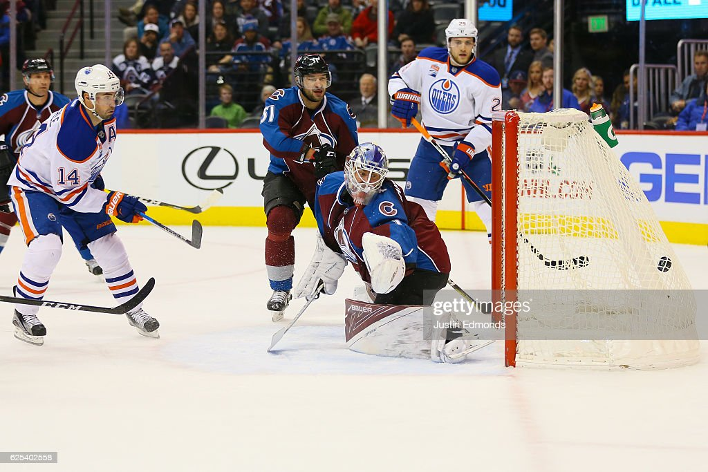 Jordan Eberle #14 of the Edmonton Oilers scores a first period goal past Semyon Varlamov #1 of the Colorado Avalanche as Fedor Tyutin #51 and Leon Draisaitl #29 look on at Pepsi Center on November 23, 2016 in Denver, Colorado.