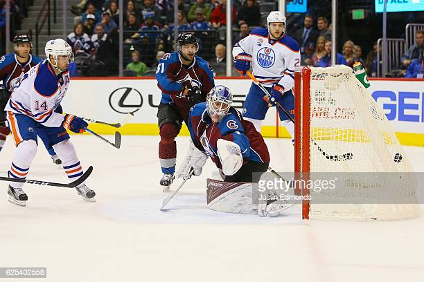 Jordan Eberle of the Edmonton Oilers scores a first period goal past Semyon Varlamov of the Colorado Avalanche as Fedor Tyutin and Leon Draisaitl...