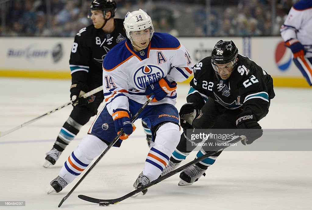 <a gi-track='captionPersonalityLinkClicked' href=/galleries/search?phrase=Jordan+Eberle&family=editorial&specificpeople=4898161 ng-click='$event.stopPropagation()'>Jordan Eberle</a> #14 of the Edmonton Oilers skates to keep control of the puck away from <a gi-track='captionPersonalityLinkClicked' href=/galleries/search?phrase=Dan+Boyle&family=editorial&specificpeople=201502 ng-click='$event.stopPropagation()'>Dan Boyle</a> #22 of the San Jose Sharks in the third period at HP Pavilion on January 31, 2013 in San Jose, California.