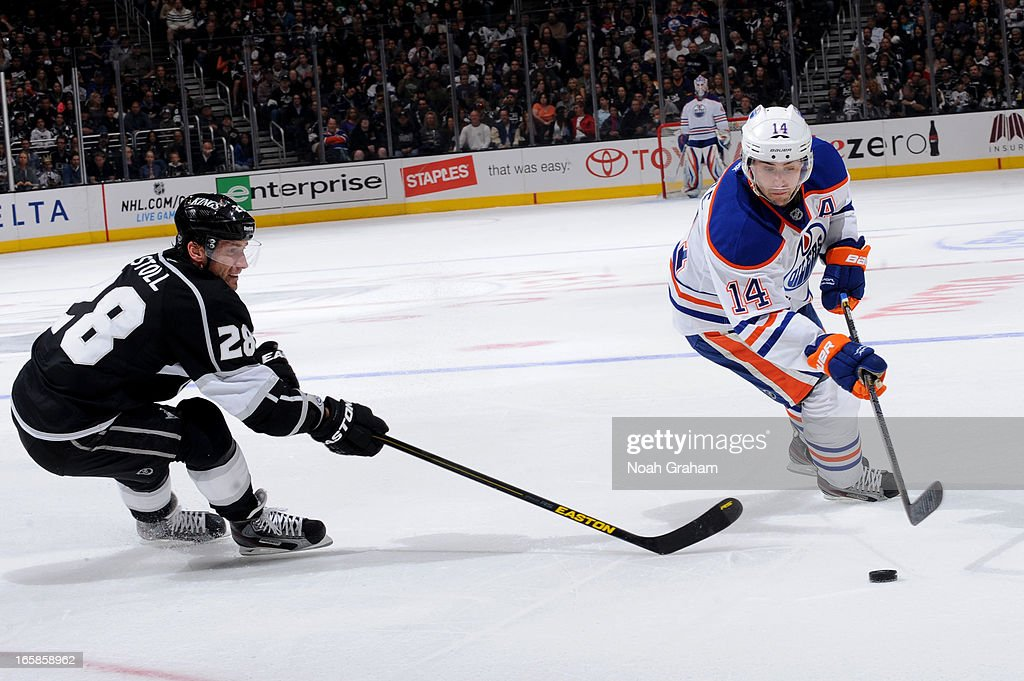 Jordan Eberle #14 of the Edmonton Oilers skates with the puck against <a gi-track='captionPersonalityLinkClicked' href=/galleries/search?phrase=Jarret+Stoll&family=editorial&specificpeople=204632 ng-click='$event.stopPropagation()'>Jarret Stoll</a> #28 of the Los Angeles Kings at Staples Center on April 6, 2013 in Los Angeles, California.