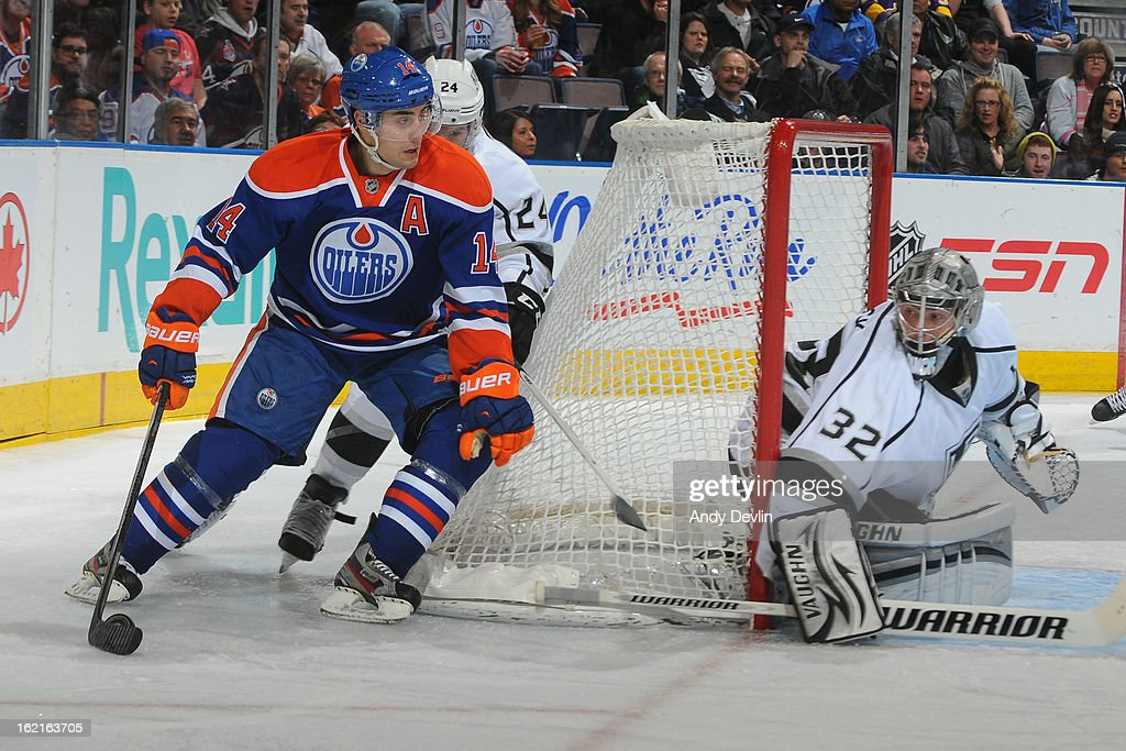 <a gi-track='captionPersonalityLinkClicked' href=/galleries/search?phrase=Jordan+Eberle&family=editorial&specificpeople=4898161 ng-click='$event.stopPropagation()'>Jordan Eberle</a> #14 of the Edmonton Oilers skates with the puck from behind the net in a game against the Los Angeles Kings on February 19, 2013 at Rexall Place in Edmonton, Alberta, Canada.