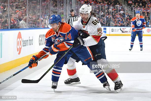 Jordan Eberle of the Edmonton Oilers skates with the puck while being pursued by Jaromir Jagr of the Florida Panthers on January 18 2017 at Rogers...