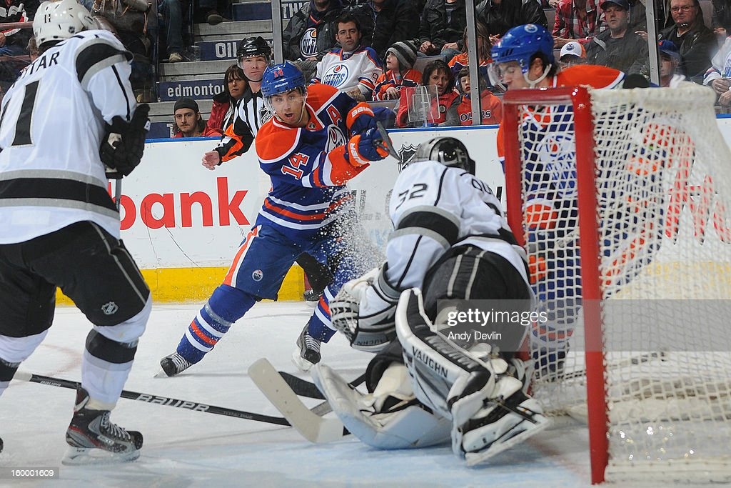 <a gi-track='captionPersonalityLinkClicked' href=/galleries/search?phrase=Jordan+Eberle&family=editorial&specificpeople=4898161 ng-click='$event.stopPropagation()'>Jordan Eberle</a> #14 of the Edmonton Oilers takes a shot against the Los Angeles Kings at Rexall Place on January 24, 2013 in Edmonton, Alberta, Canada.