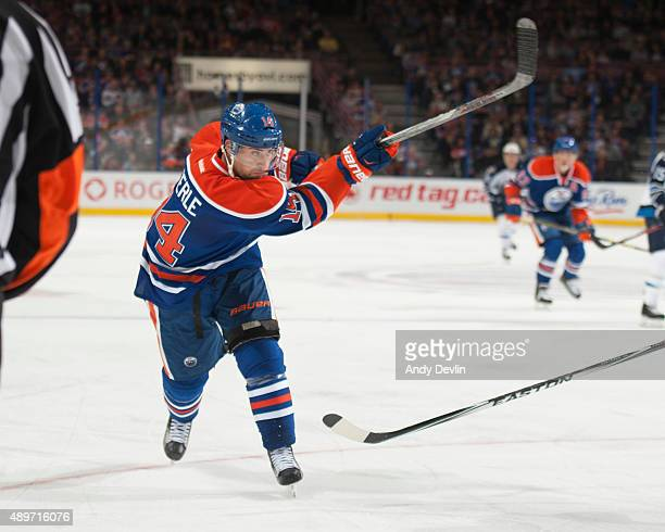 Jordan Eberle of the Edmonton Oilers takes a shot during a preseason game against the Winnipeg Jets on September 23 2015 at Rexall Place in Edmonton...